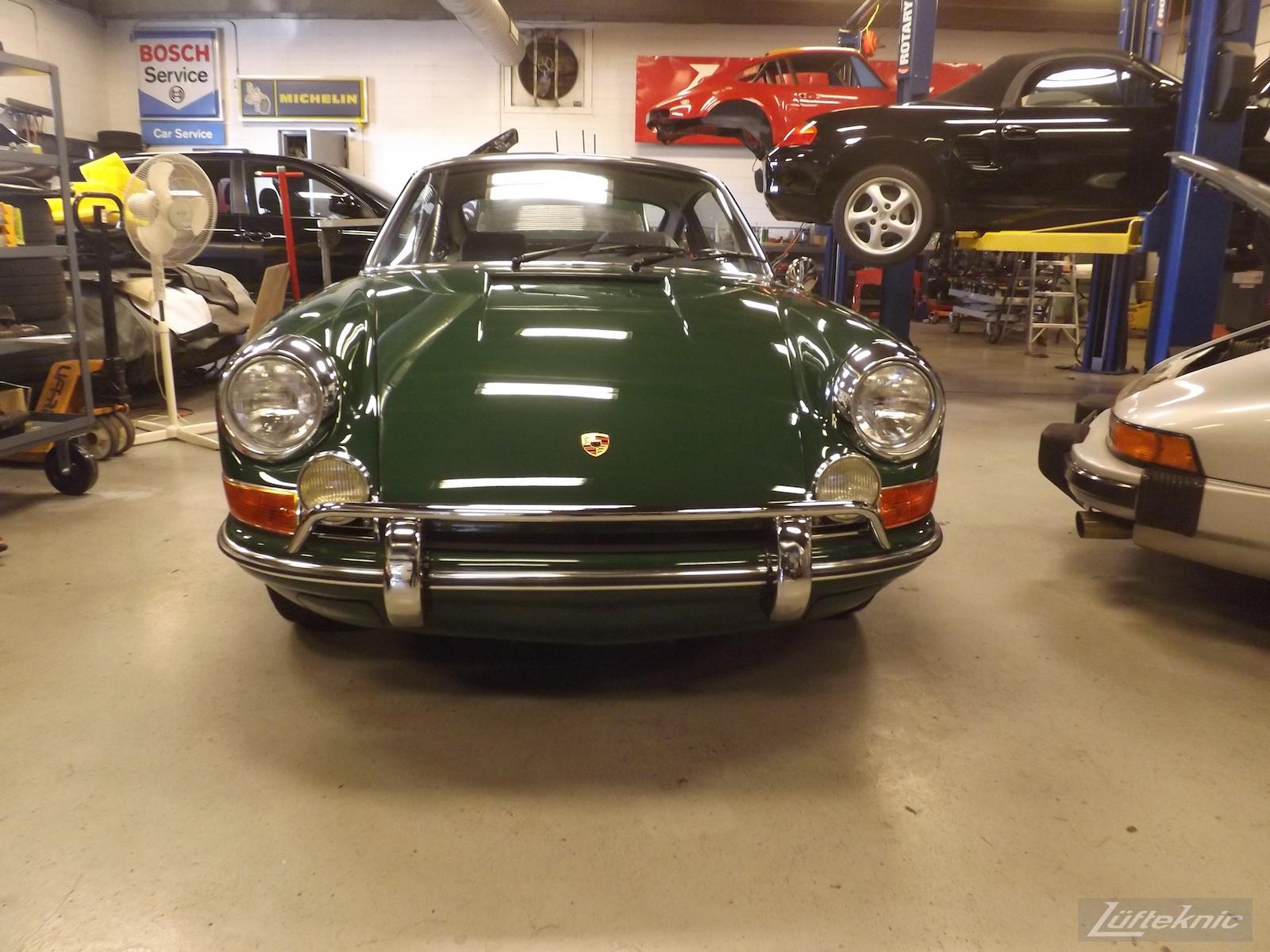 A freshly restored Irish Green Porsche 912 sits inside the Lufteknic shop.