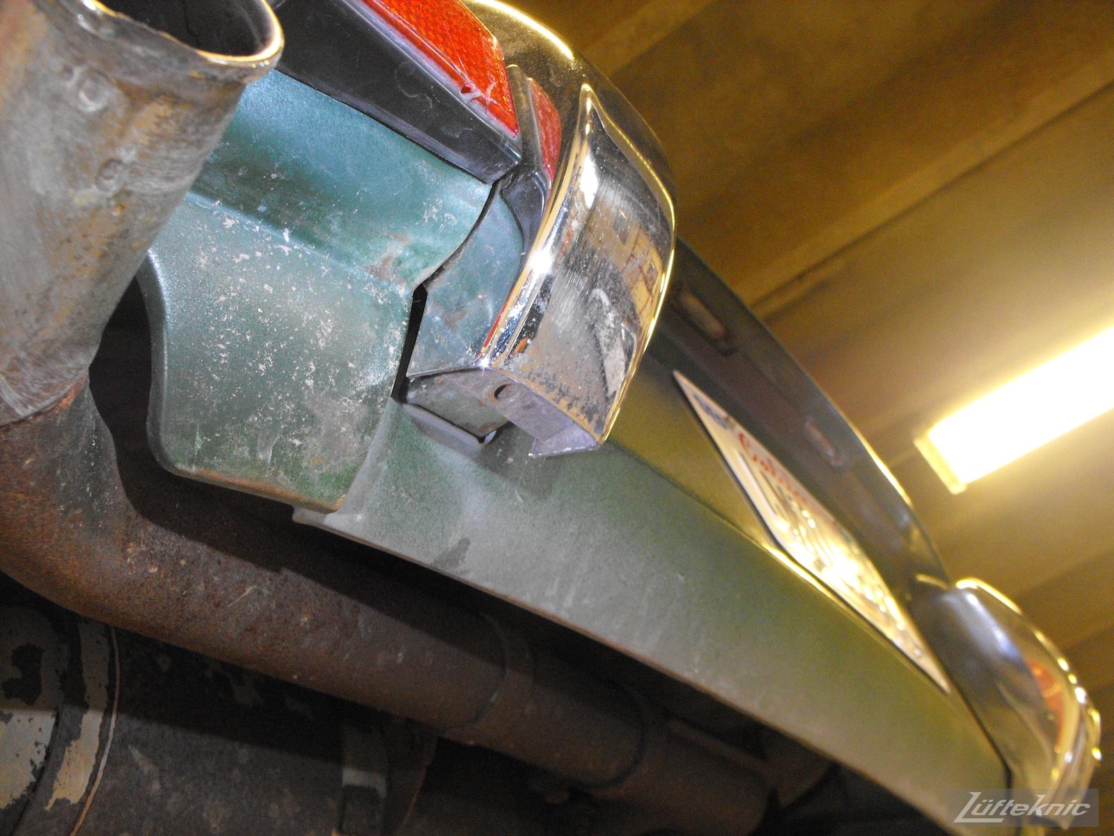 An Irish Green Porsche 912 undergoing restoration at Lufteknic with uneven body panels shown.