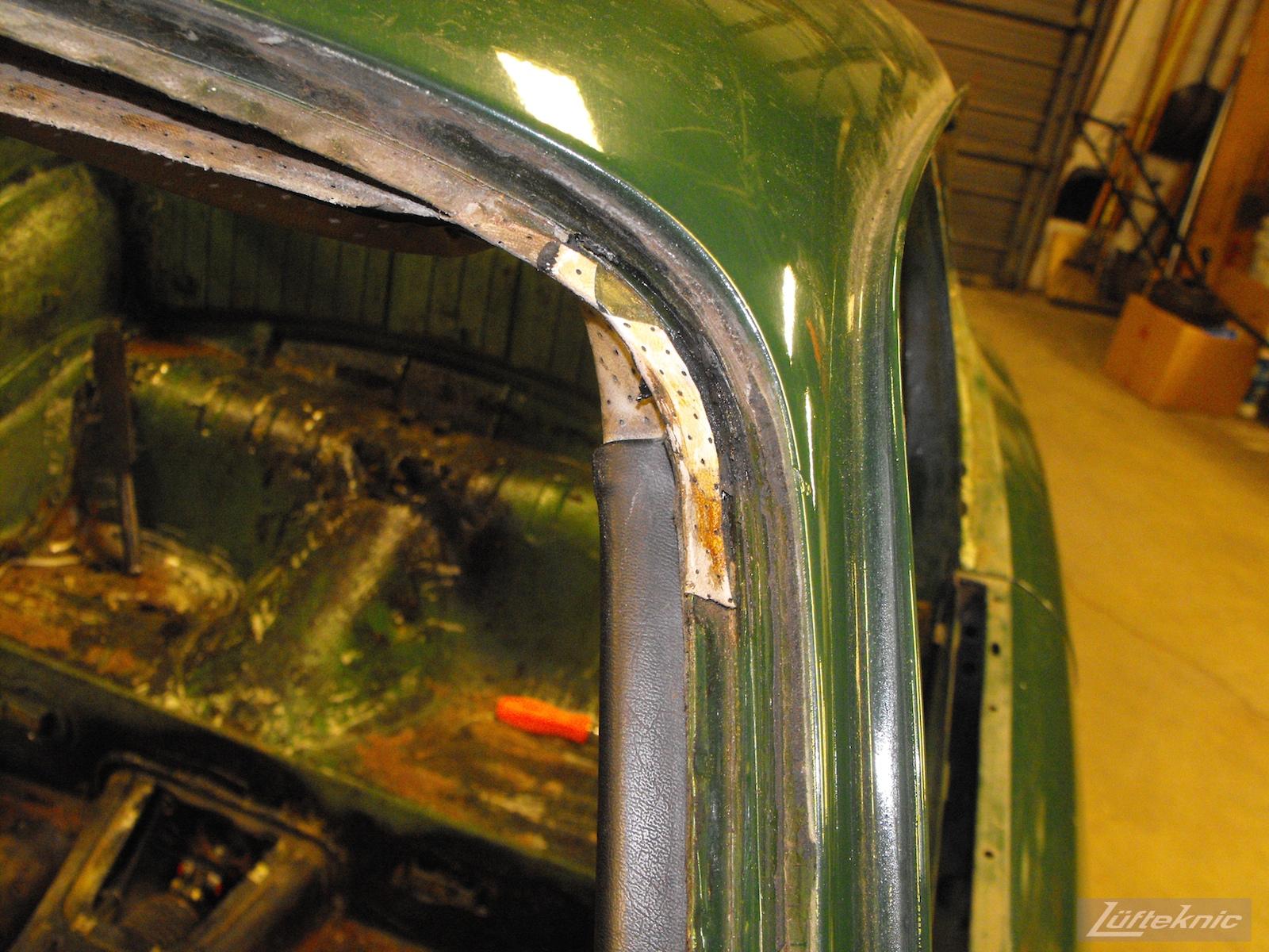 Upper headliner detail with the windshield removed on an Irish Green Porsche 912 undergoing restoration at Lufteknic.