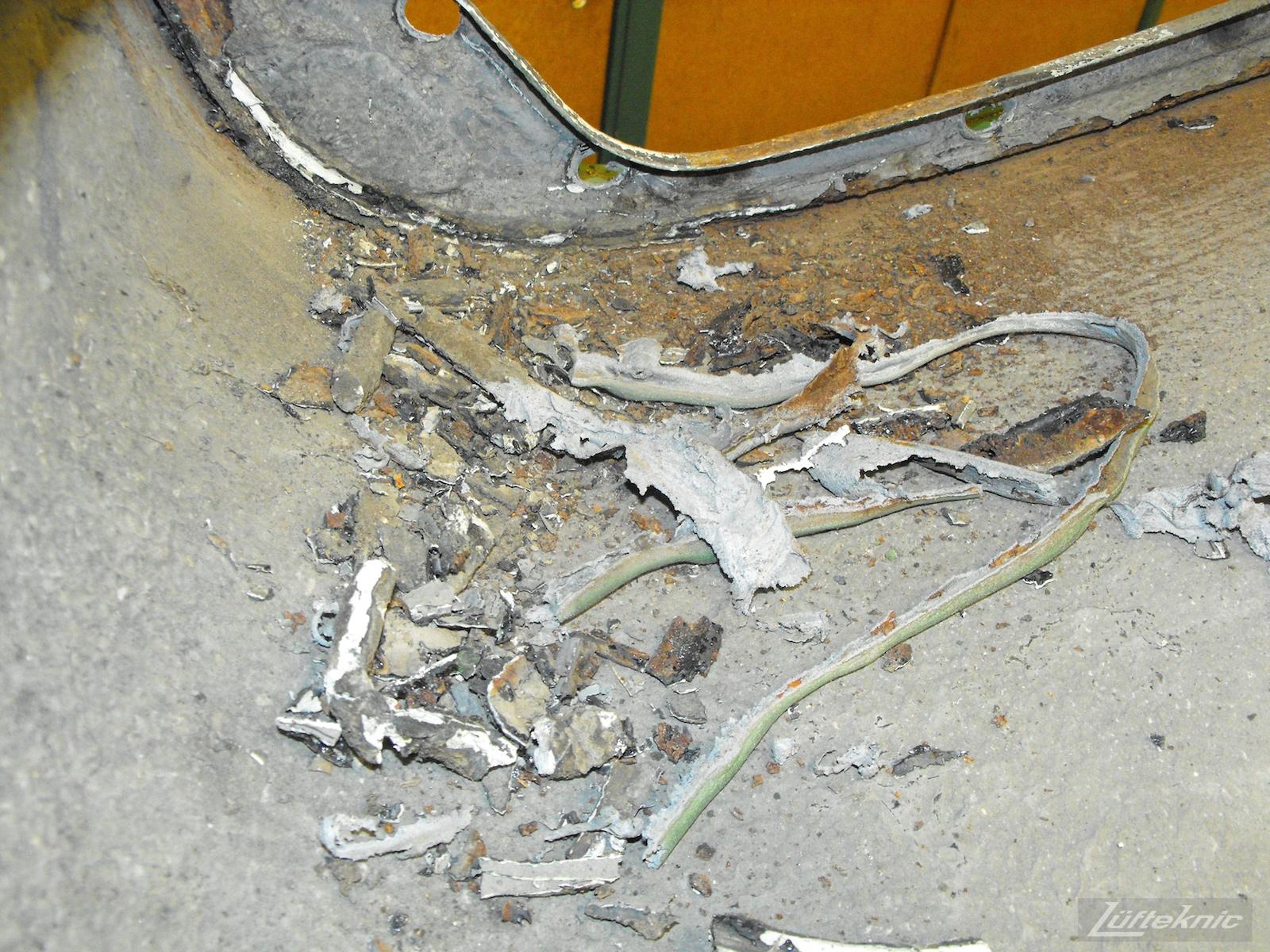 Debris removed from an Irish Green Porsche 912 undergoing restoration at Lufteknic.