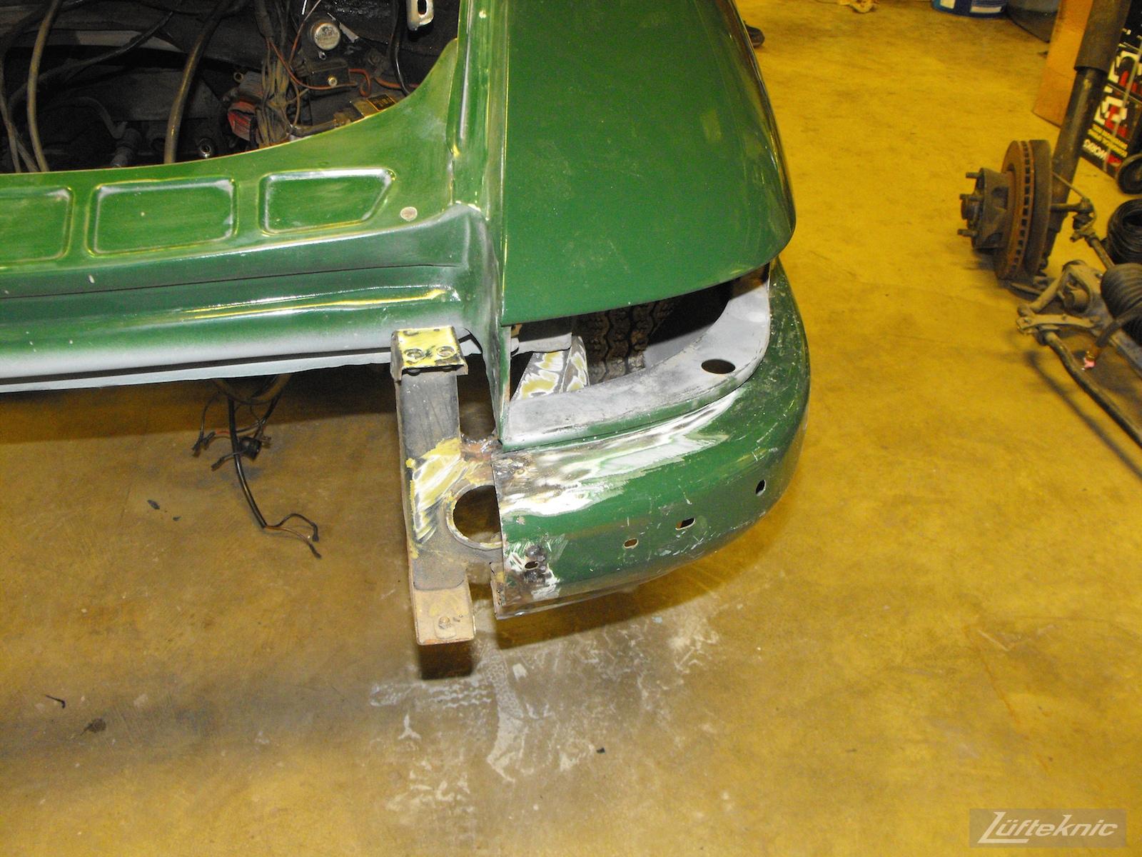 Rear bumper repair on an Irish Green Porsche 912 undergoing restoration at Lufteknic.