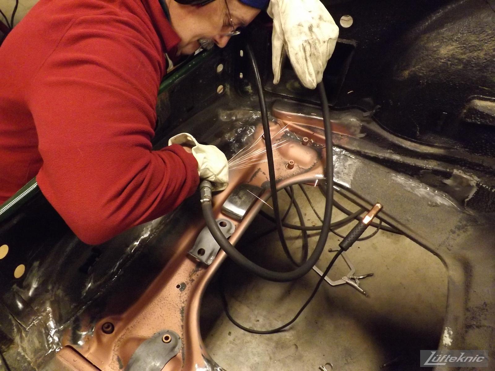 Grinding down welds on an Irish Green Porsche 912 undergoing restoration at Lufteknic.