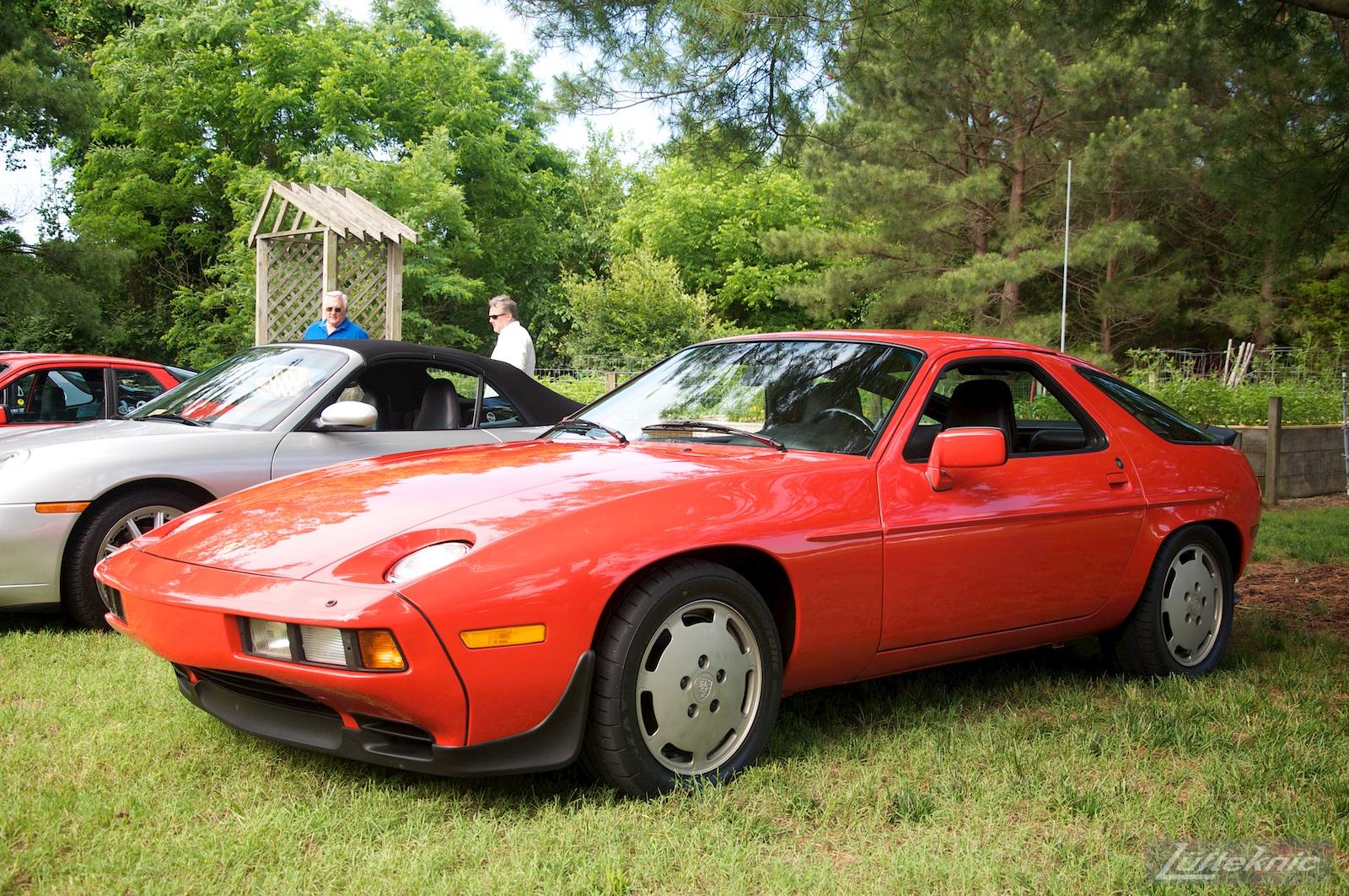 A red 928 at the Richmond Porsche Meet.