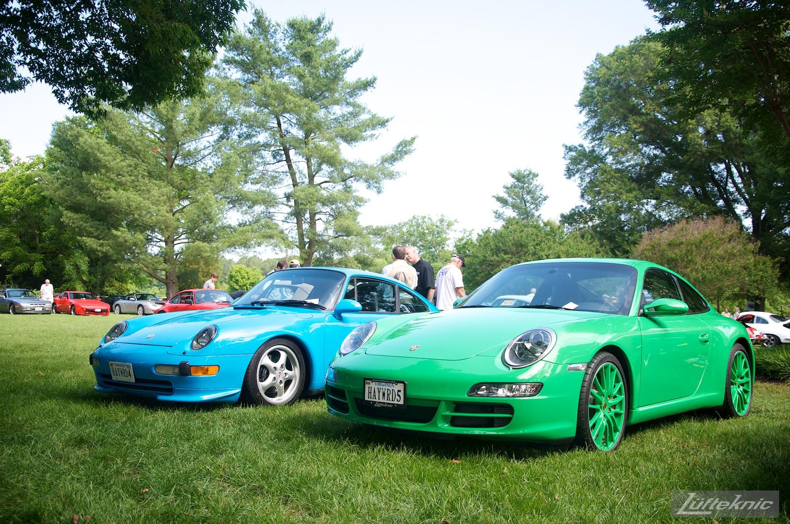 Riviera Blue 993 and Signal Green 997 Porsches at the Richmond Porsche Meet.