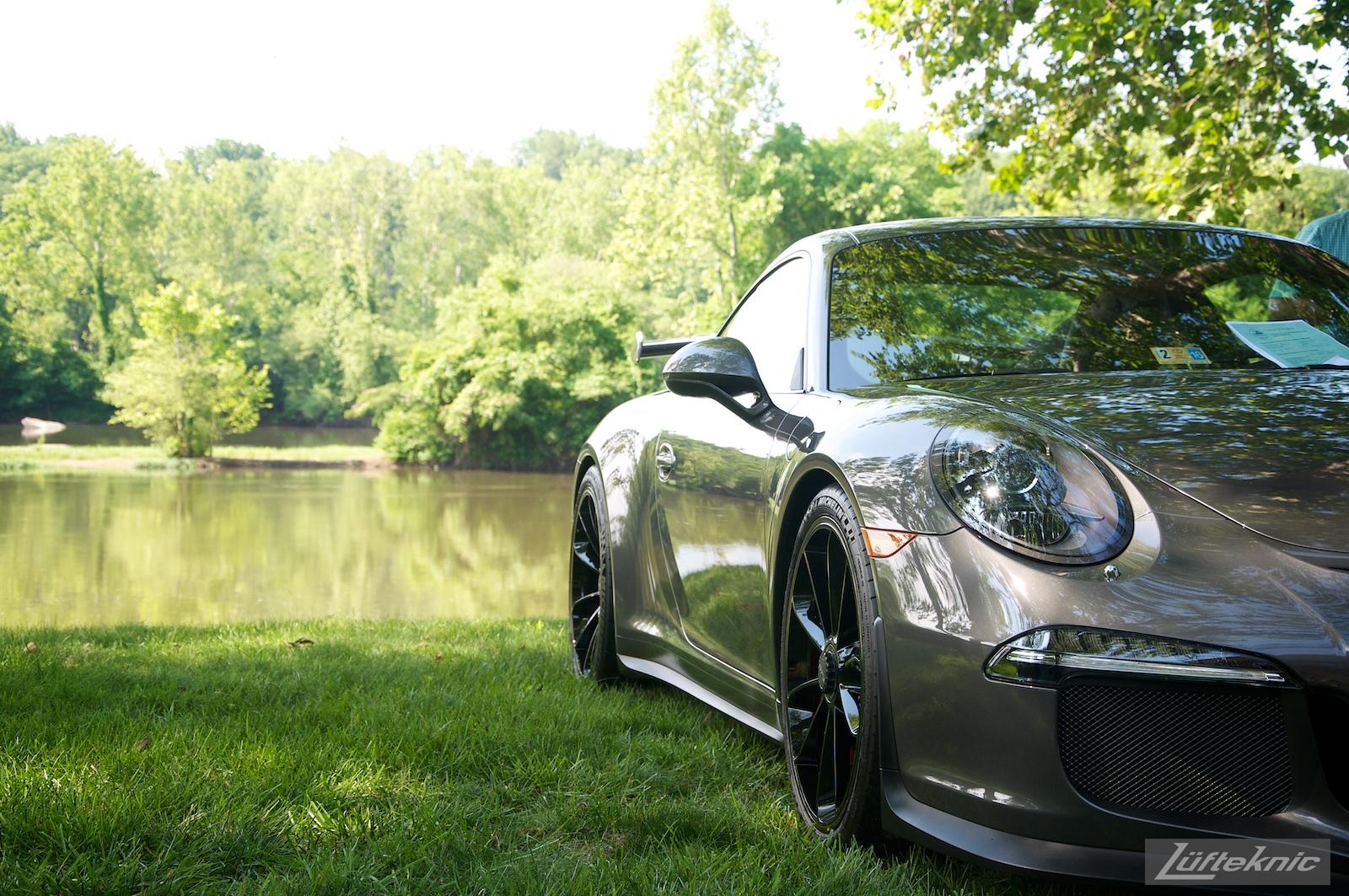A gray 991 Gt3 next to the james river at the Richmond Porsche Meet.