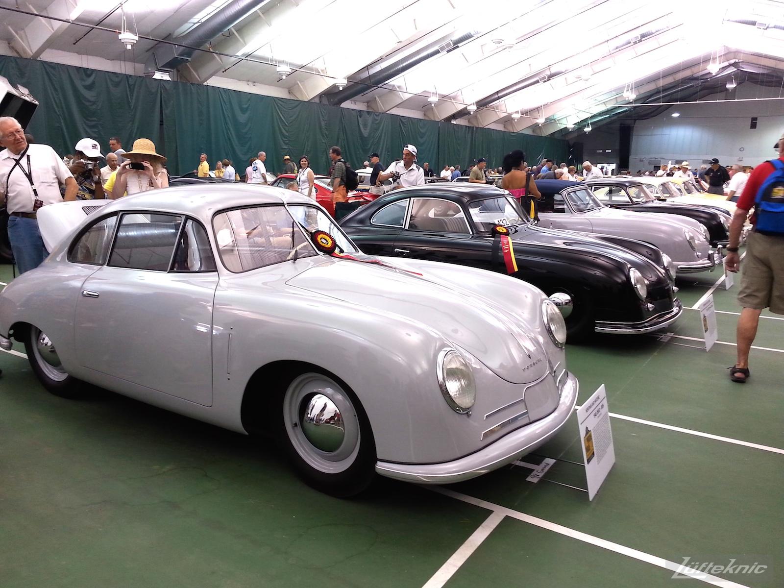 A line of Porsche 356 cars.