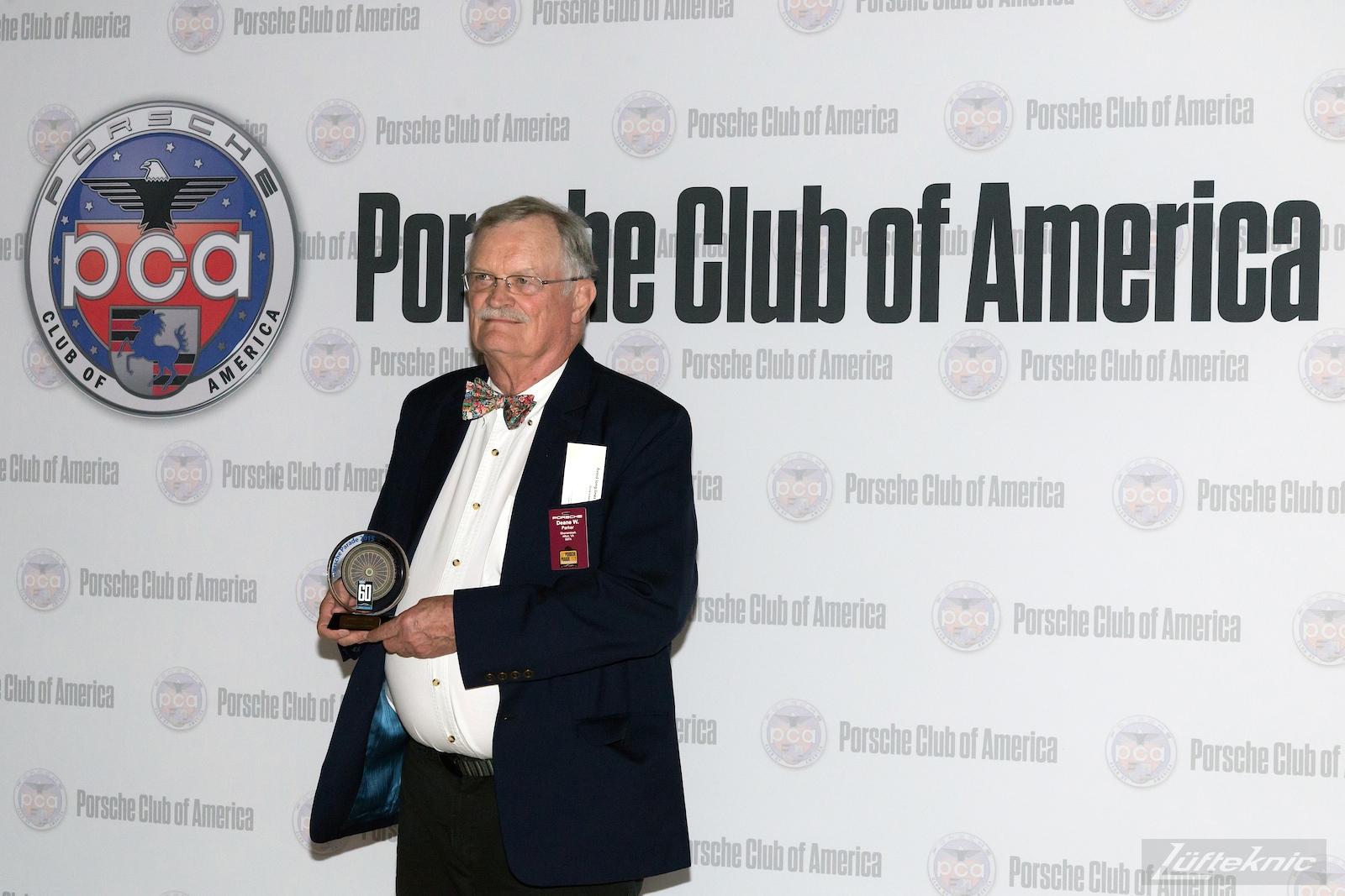 Deane receives his award at Porsche Parade