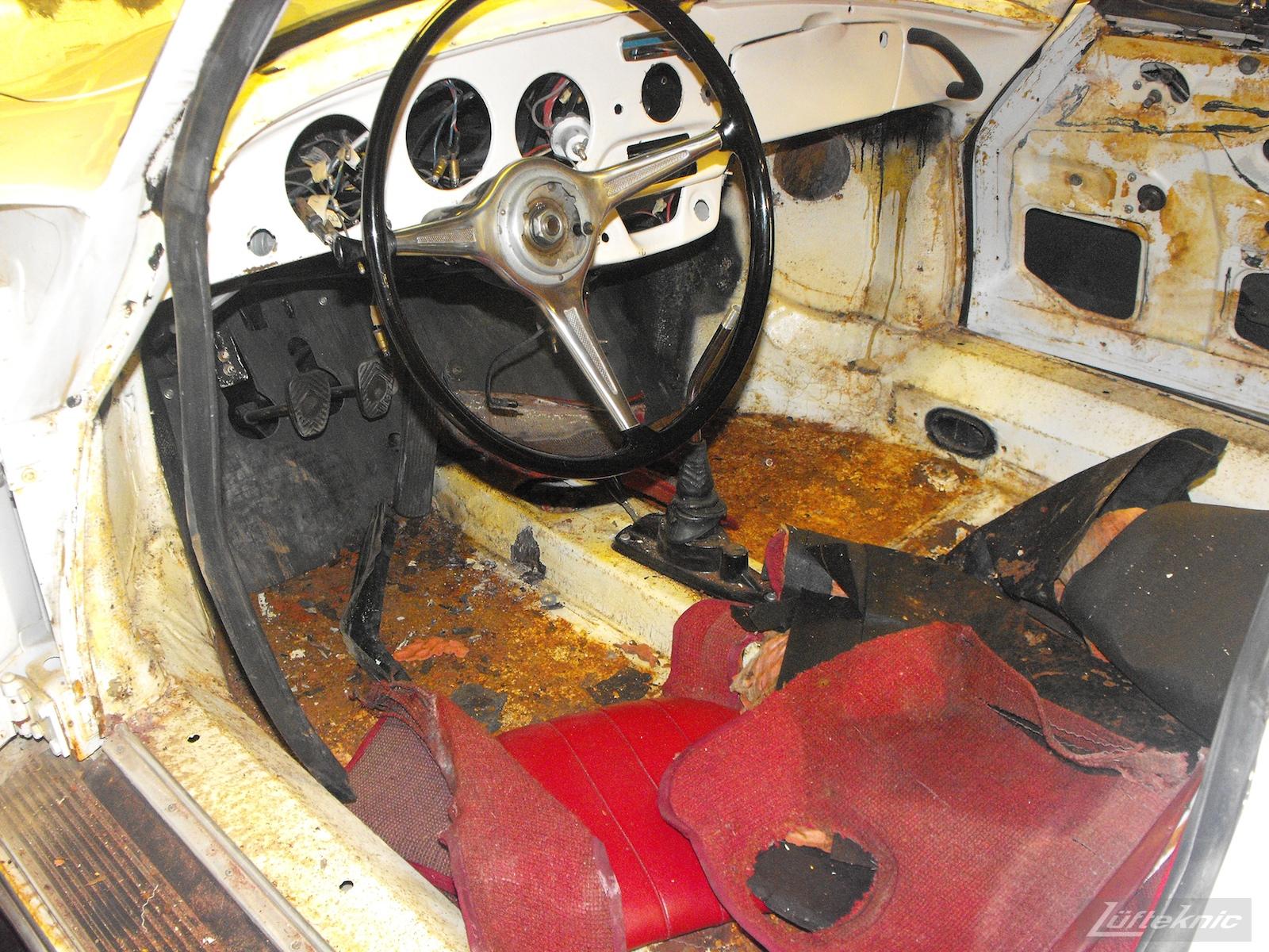 Rusty floors and interior on a 1964 Porsche 356SC restoration.