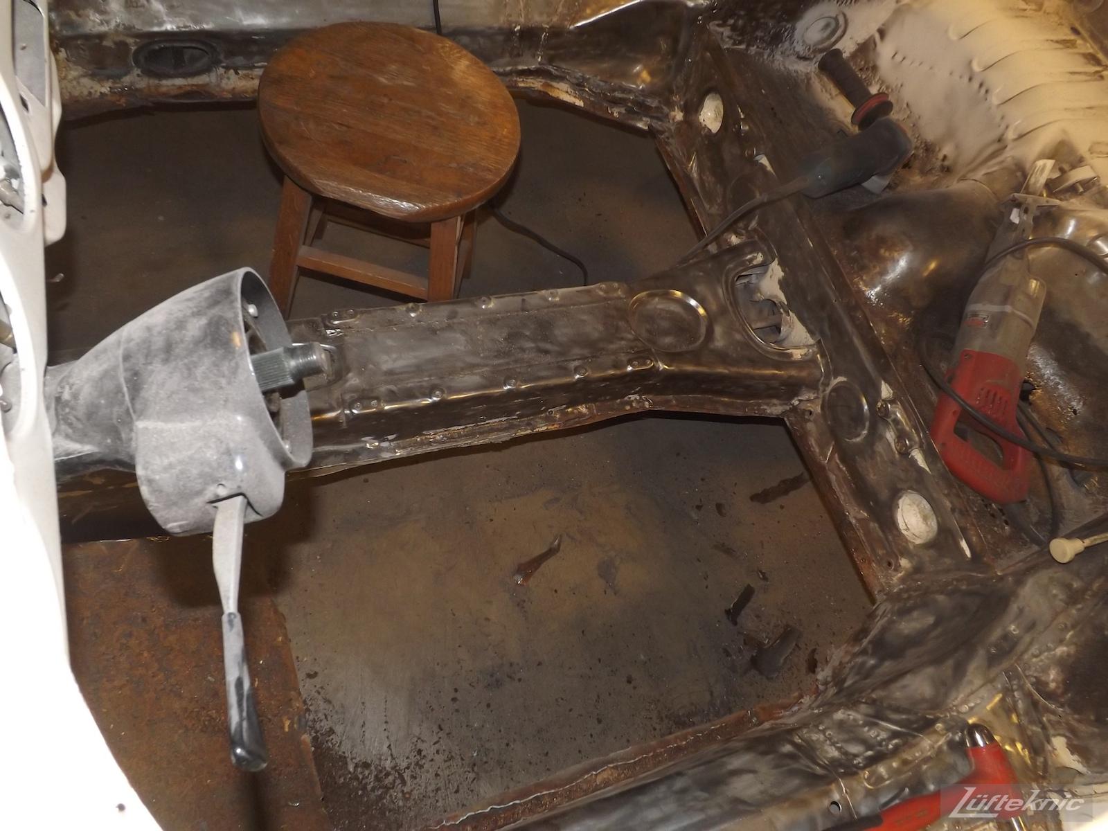 Rust damaged floors being cut away on a 1964 Porsche 356SC restoration.