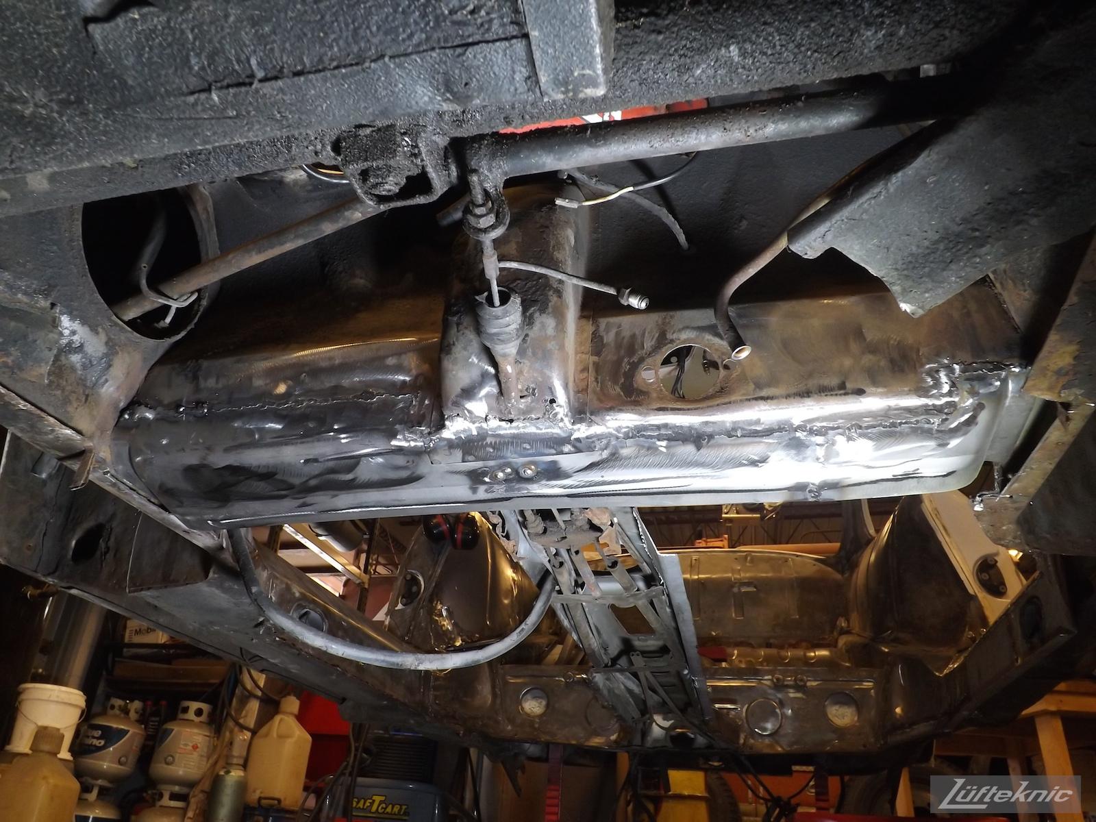 Rust damaged floors cut away on a1964 Porsche 356SC restoration.