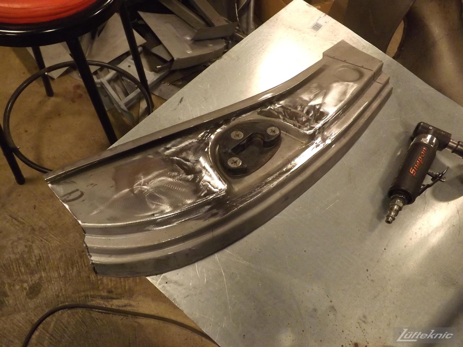 Door latch repair on a White 1964 Porsche 356SC being restored.